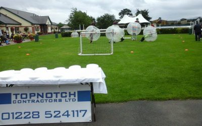 Top Notch Contractors Ltd help Impact Housing Association celebrate their 40th year with 'bubble football' at the Impact fun day at Carlisle Racecourse.